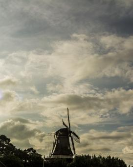 Free Stock Photo of Dutch Corn Mill Against the Sky