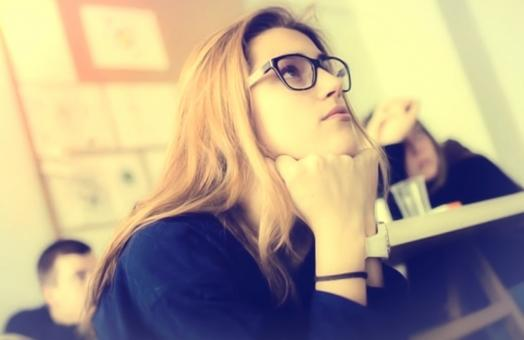Free Stock Photo of Hazy Vintage Looks - Young Woman with Glasses - Attentive - Classroom