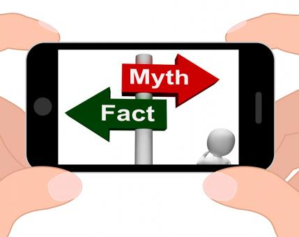 Free Stock Photo of Fact Myth Signpost Displays Facts Or Mythology