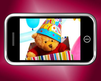 Free Stock Photo of Teddy Bear Birthday Gift Photo On Smartphone