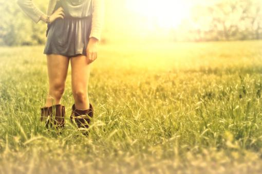Free Stock Photo of Hazy Vintage Looks - Country Girl on the Grass - With Copyspace