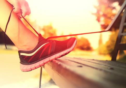 Free Stock Photo of Running Shoes - Woman Tying Shoe Laces