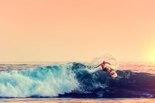 Free Stock Photo of Surfer at Sunset - Color Filtered