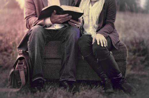 Free Stock Photo of Couple in Love Reading Outdoors - Washed-out Effect