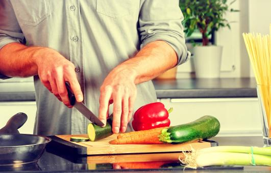 Free Stock Photo of Cooking - A Man Chopping Veggies