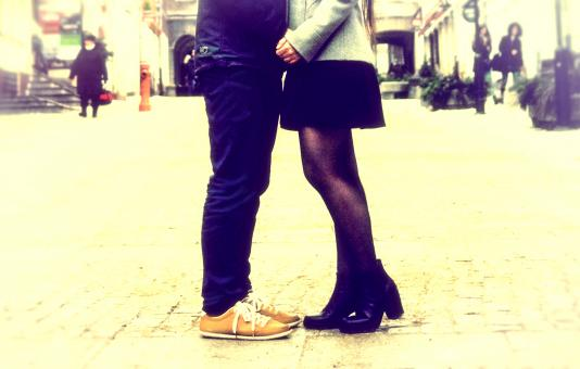 Free Stock Photo of Close Up of Legs - Couple Kissing - Vintage Grainy Looks