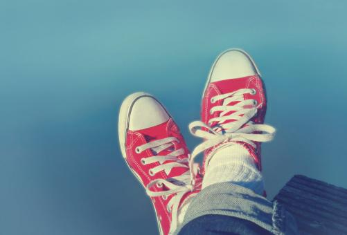 Free Stock Photo of Feet Crossed - Relaxation and Satisfaction - Red Sneakers
