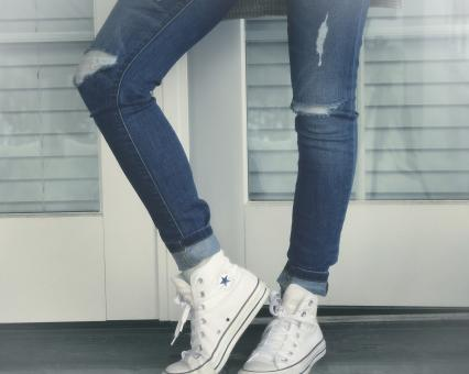 Free Stock Photo of Urban Girl - Close-Up of Legs - Ripped Jeans and Sneakers