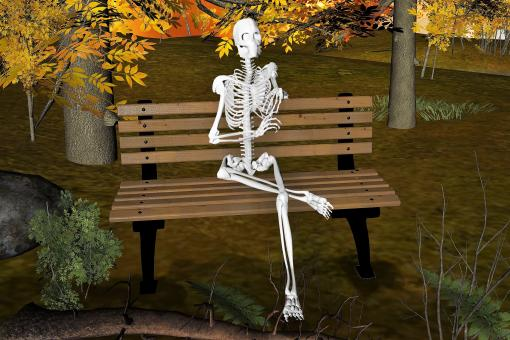 Free Stock Photo of Skeleton Sitting on Bench