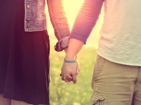 Free Stock Photo of Couple Walking Hand in Hand