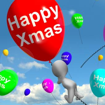 Free Stock Photo of Balloons Floating In The Sky With Happy Xmas Message