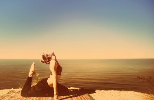 Free Stock Photo of Woman Practicing Yoga by the Ocean - Metal Toned