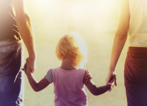 Free Stock Photo of Into the Light - Parents Hold Hands with their Child