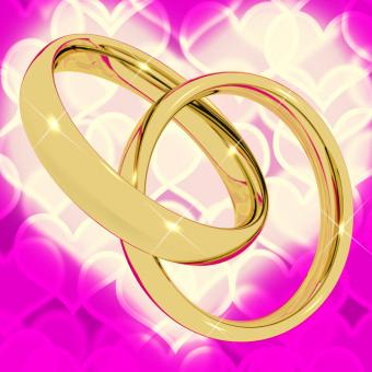 Free Stock Photo of Gold Rings On Pink Heart Bokeh Background Representing Love Valentine