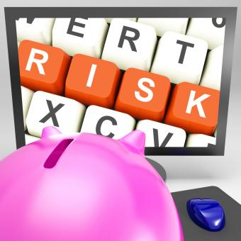 Free Stock Photo of Risk Keys On Monitor Showing Investment Risks