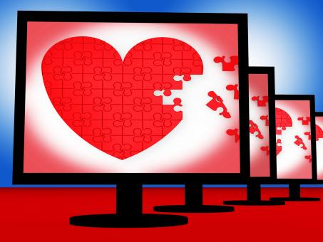 Free Stock Photo of Puzzle Heart On Monitors Shows Love