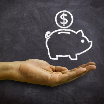 Free Stock Photo of Piggy Bank on Blackboard - Savings and Economies Concept