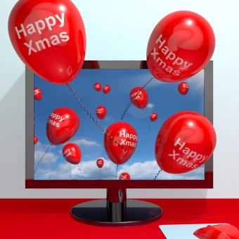 Free Stock Photo of Red Balloons With Happy Xmas From Computer Screen For Online Greetings