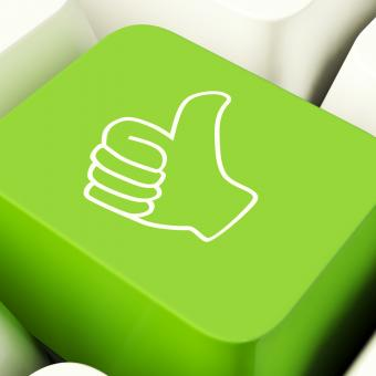 Free Stock Photo of Thumbs Up Computer Key In Green Showing Approval And Being A Fan