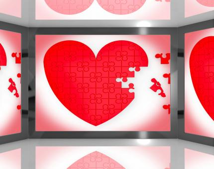 Free Stock Photo of Puzzle Heart On Screen Showing Romantic Movies And Soap Operas