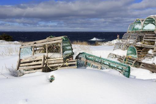Free Stock Photo of Snow covered lobster traps near ocean