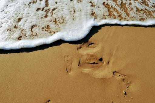 Free Stock Photo of The imprint of a bare foot on the sand