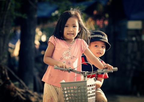 Free Stock Photo of Siblings with a Bike
