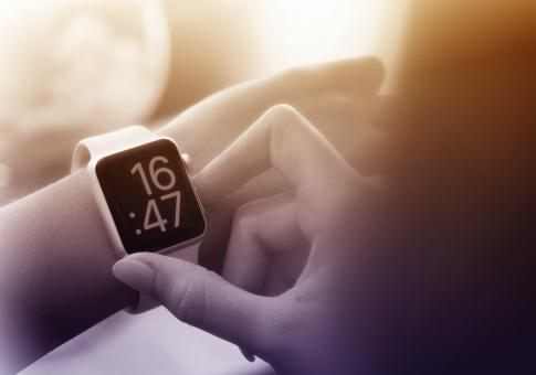Free Stock Photo of Time to Go - A Woman Checks the Time on Smartwatch