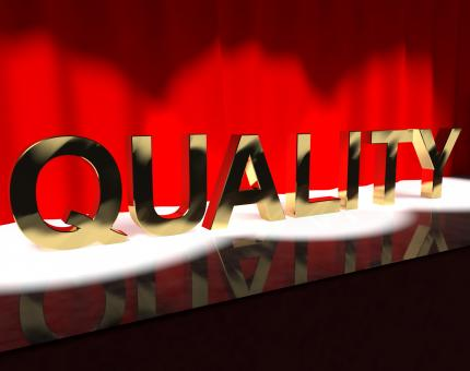 Free Stock Photo of Quality Word On Stage Showing Excellence Perfection And Improvement