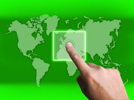 Free Stock Photo of Hand Touch Touchscreen On World Map Shows Internet WWW