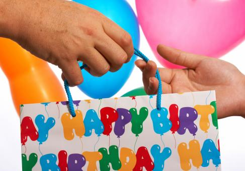 Free Stock Photo of Giving A Birthday Gift Or Present