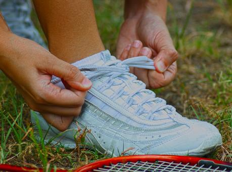 Free Stock Photo of Tying Shoes Ready For A Game Of Badminton