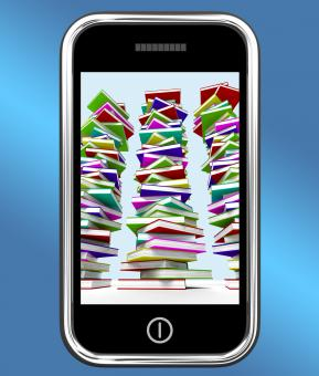 Free Stock Photo of Mobile Phone With Stacks Of Books Shows Online Knowledge