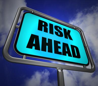 Free Stock Photo of Risk Ahead Signpost Shows Dangerous Unstable and Insecure Warning