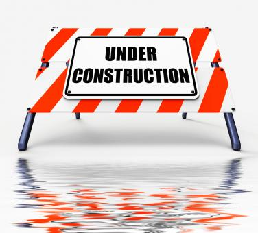 Free Stock Photo of Under Construction Sign Displays Partially Insufficient Construct