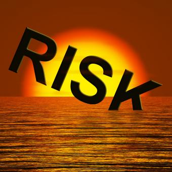 Free Stock Photo of Risk Word Sinking In The Sea Showing Uncertainty