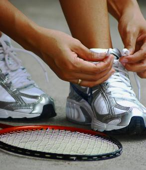 Free Stock Photo of Tying Shoe Laces Ready For A Game Of Badminton