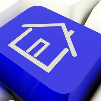 Free Stock Photo of House Symbol Computer Key In Blue Showing Real Estate Or Rentals