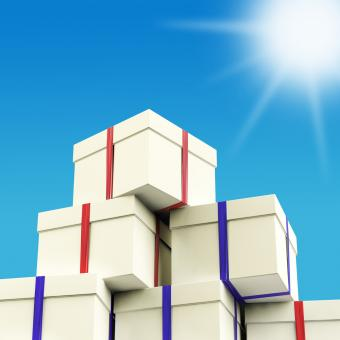 Free Stock Photo of Stack Of Giftboxes With Sun And Sky Background As Presents For The Fam