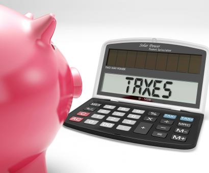 Free Stock Photo of Taxes On Calculator Shows Income Tax Return