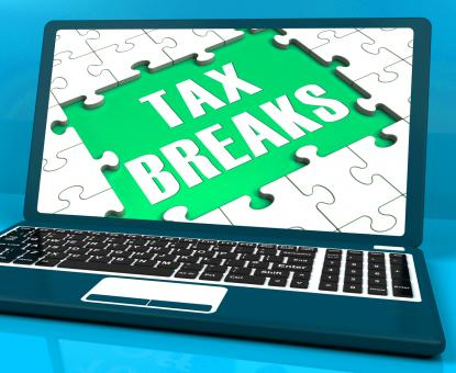 Free Stock Photo of Tax Breaks On Laptop Showing Internet Taxing