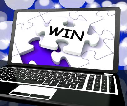 Free Stock Photo of Win Puzzle On Laptop Shows Victory