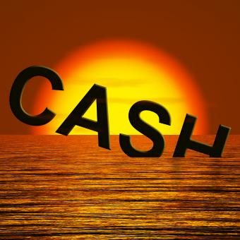 Free Stock Photo of Cash Sinking And Sunset Showing Depression Recession And Economic Down