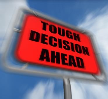 Free Stock Photo of Tough Decision Ahead Sign Displays Uncertainty and Difficult Choice