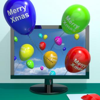 Free Stock Photo of Colorful Balloons With Merry Xmas From Computer Screen For Online Gree