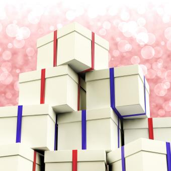 Free Stock Photo of Stack Of Giftboxes With Bokeh Background As Presents For The Family