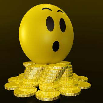 Free Stock Photo of Surprised Smiley With Coins Shows Unexpected Earnings