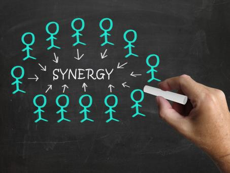 Free Stock Photo of Synergy On Blackboard Means Teamwork And Partnership