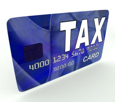 Free Stock Photo of Tax On Credit Debit Card Shows Taxes Return IRS