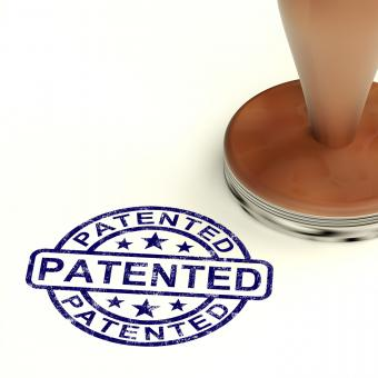 Free Stock Photo of Patented Stamp Showing Registered Patent Or Trademarks